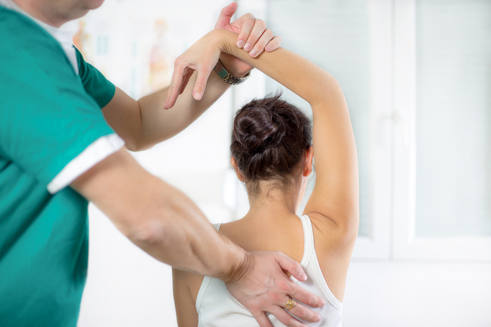 Woman Getting A Chiropractic Adjustment to her back