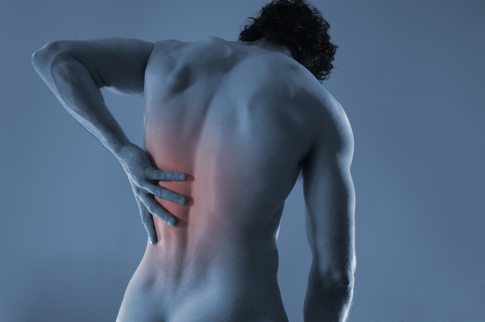 person has fibromyalgia pain on their back in Temple, TX